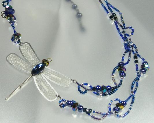 medical waste dragonfly wings and iridescent blue crystal bead necklace