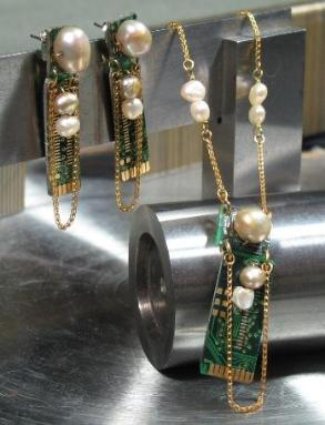 green jewelry earrings and necklace with gold circuit boards and pearls