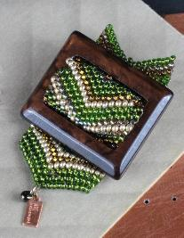 Brown & green one of a kind hand beaded vintage buckle pin